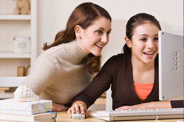 Mother and daughter sharing the computer | Sheknows.com
