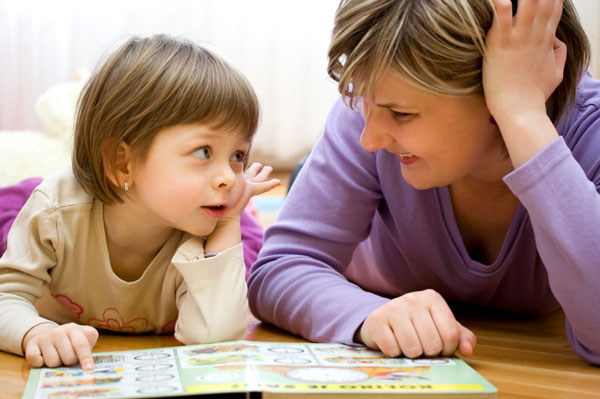 Mother reading with child | Sheknows.com.au