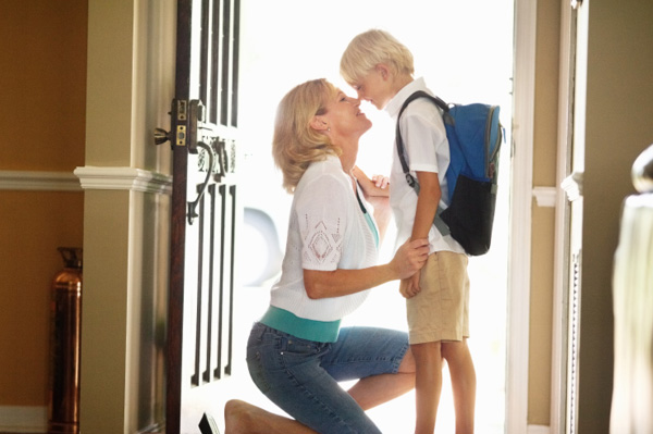 Mother seeing little boy off to school