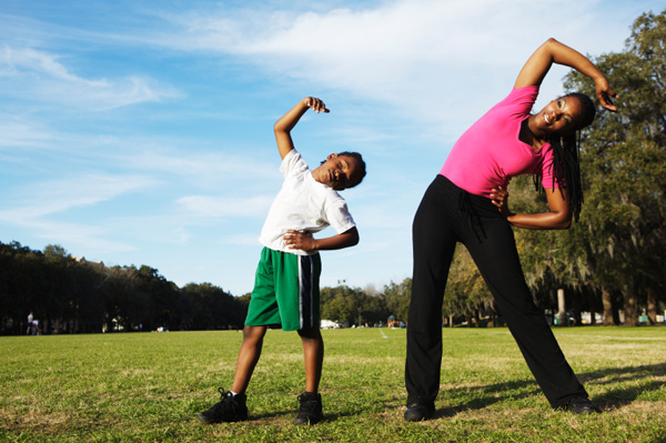 Mother and son exercising together