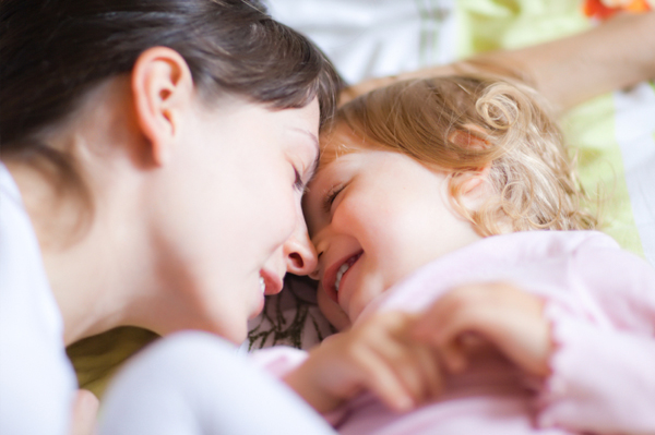 Mother with toddler in bed