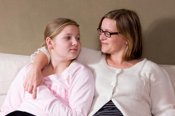 Mother talking to teenage daughter