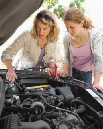 Mother and teen daughter repairing car | Sheknows.com