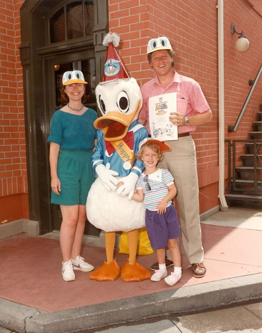The Clintons posing with Donald Duck