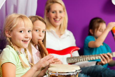 Mom playing instruments with children