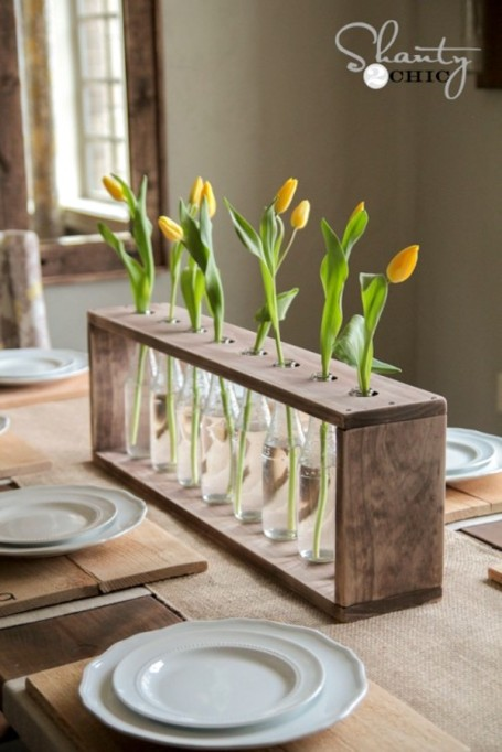 Glass bottle and wood vase centerpiece