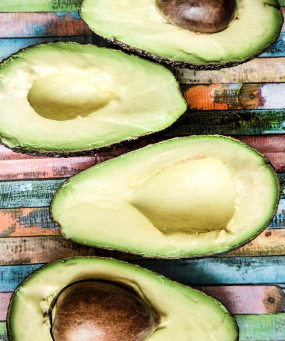 avocados on colorful wooden table