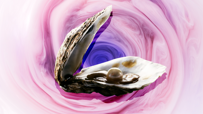 Oyster open with pearl inside on