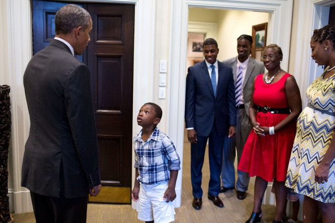 Young boy meets Barack Obama