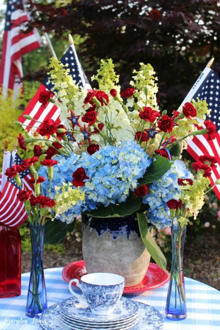Mini American flags in floral arrangement