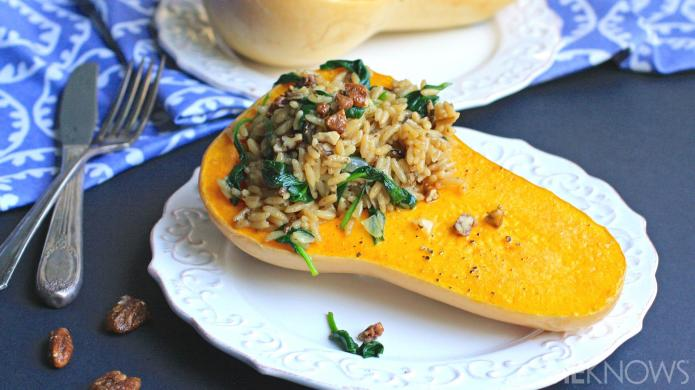Vegan brown rice and spinach-stuffed butternut
