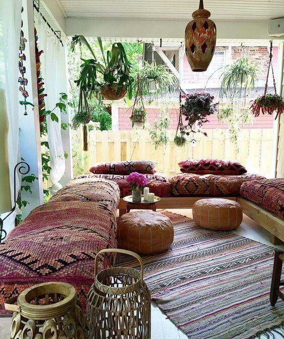 Porch with lots of hanging plants and bench seating