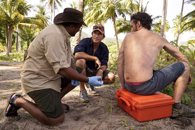 Medic and Jeff Probst evaluate Neil Gottlieb's back injury on Survivor: Kaoh Rong