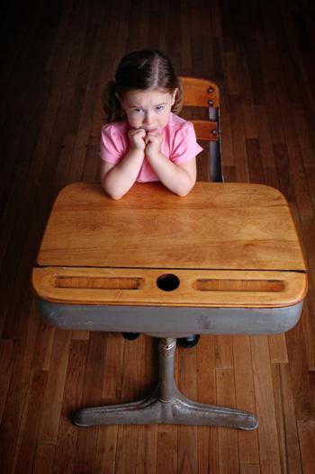 Nervous Girl at School Desk