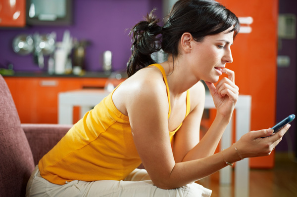 Nervous woman texting