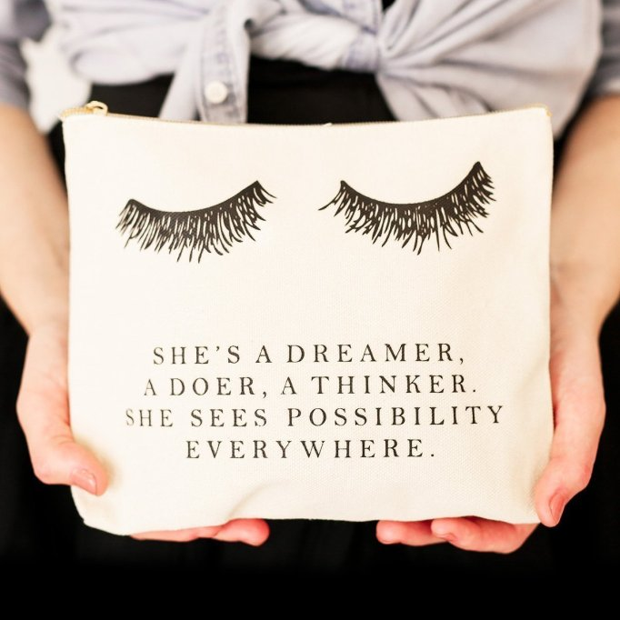 "Makeup bag with ""she's a dreamer, a doer, a thinker, she sees possibility, everywhere"" on it"