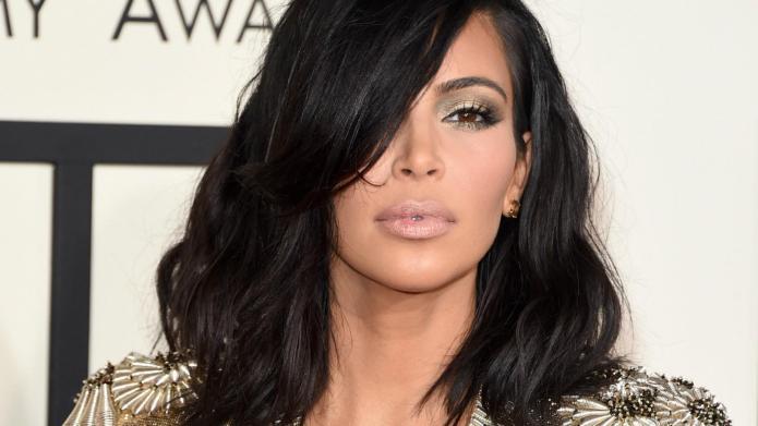Kim Kardashian wears a golden robe