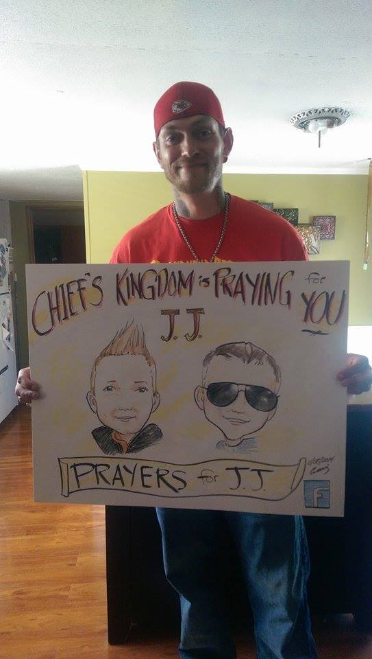 Noah Kauffman with Prayers for J.J. sign