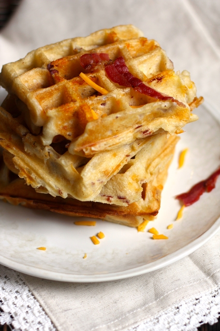 11 Sweet and Savory Waffle Recipes: Maple syrup adds sweetness to these cheesy bacon waffles.