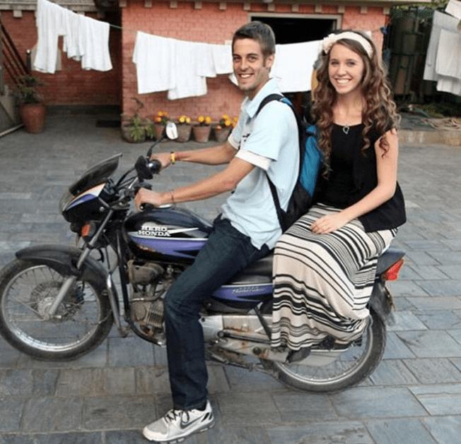 Derick Dillard and Jill Duggar riding a motorcycle