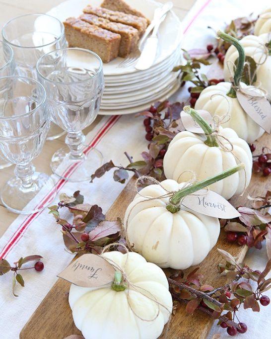18 Homemade Thanksgiving Table Ideas That Even the DIY-Challenged Can Manage: Thanksgiving table with white pumpkins and cranberry