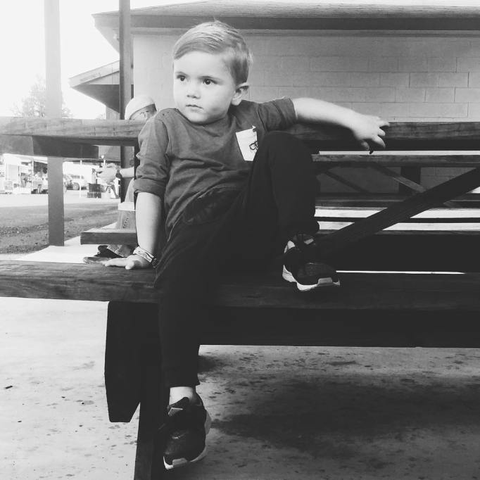 baby sitting on bench
