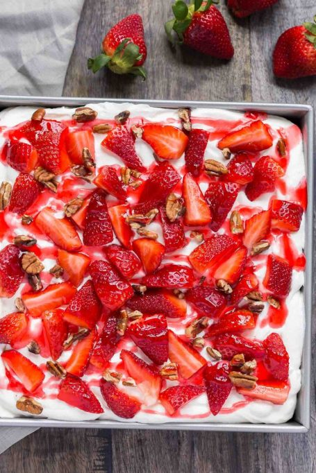 Strawberries and cream icebox poke cake from Baked By An Introvert