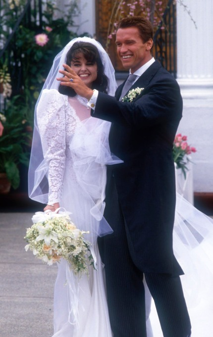 Arnold Schwarzenegger with his new wife Maria Shriver outside St. Francis Xavier Church after their wedding