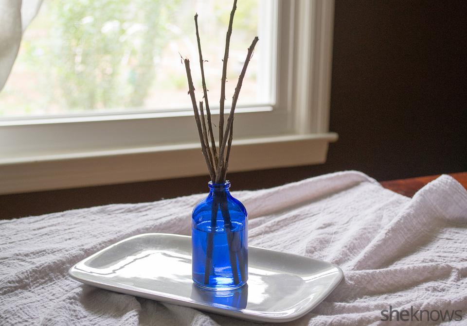 DIY Oil Defuser Step 4 add pealed twigs