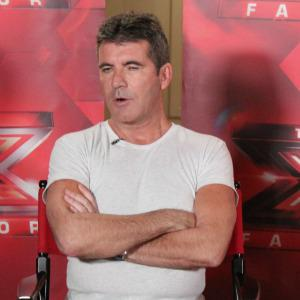 Simon Cowell: Celebs who thumb their