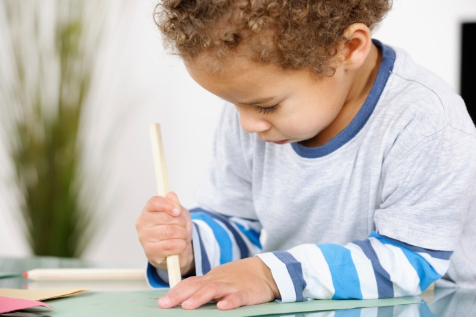 Close-up Of Toddler Concentrating Doing Artwork
