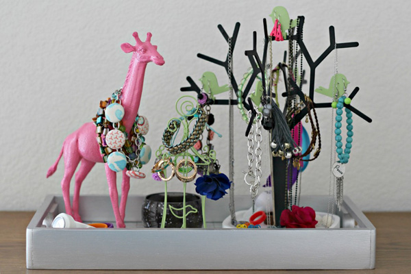 Use spray paint on an old plastic animal to turn it into an instantly chic jewelry holder.
