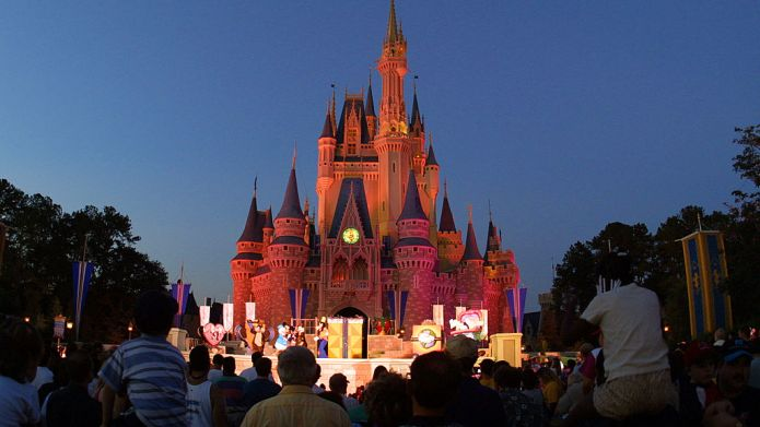 397155 13: People watch a show on stage in front of Cinderella's castle at Walt Disney World's Magic Kingdom November 11, 2001 in Orlando, Florida. (Photo by Joe Raedle/Getty Images)