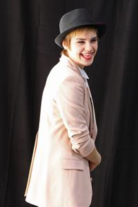 Emma Watson flashes top hat in