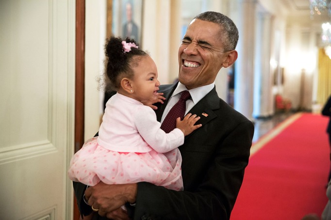 Obama making a funny face to a child