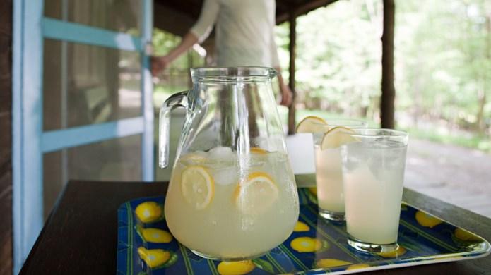 Tray of lemonade, woman in background
