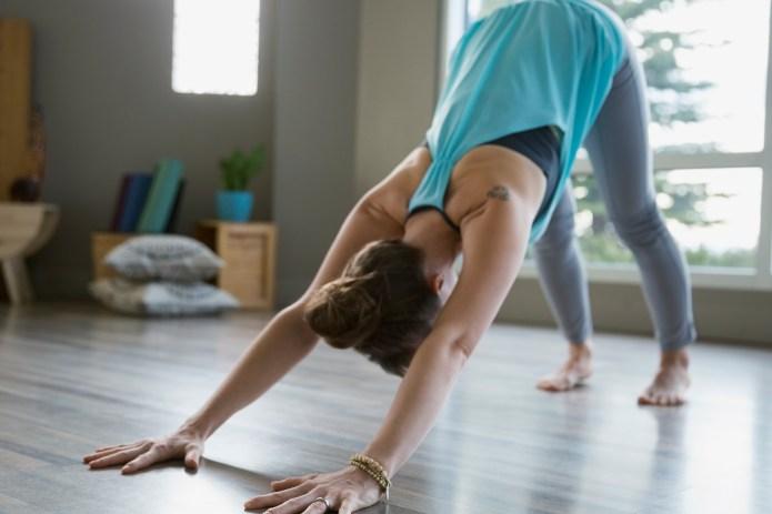 Woman practicing yoga in downward facing