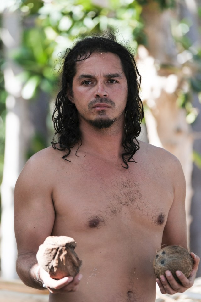 Ozzy Lusth works at camp on Survivor: Game Changers