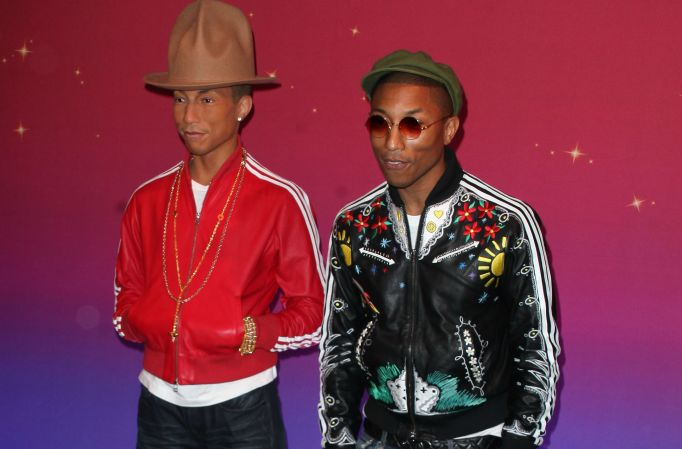 Pharrell Williams with his wax figure