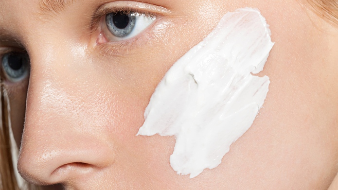 Close-up of cream on a woman's