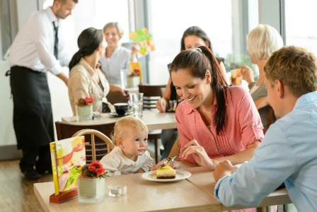 Parents at restaurant with toddler
