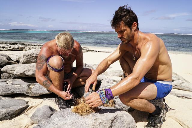 Paul Wachter and Ken McNickle work at camp on Survivor: Millennials Vs. Gen-X