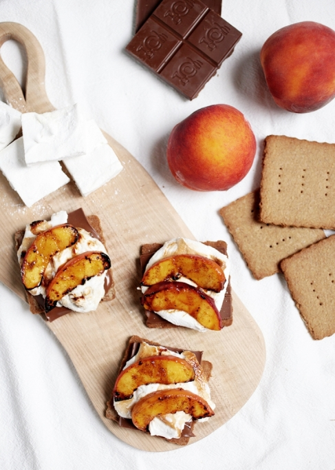 Grilled dessert recipes: Grilled peach s'mores are a fruity summer treat.