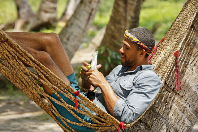 Peter Baggenstos lays in Gondol tribe's hammock on Survivor: Kaoh Rong