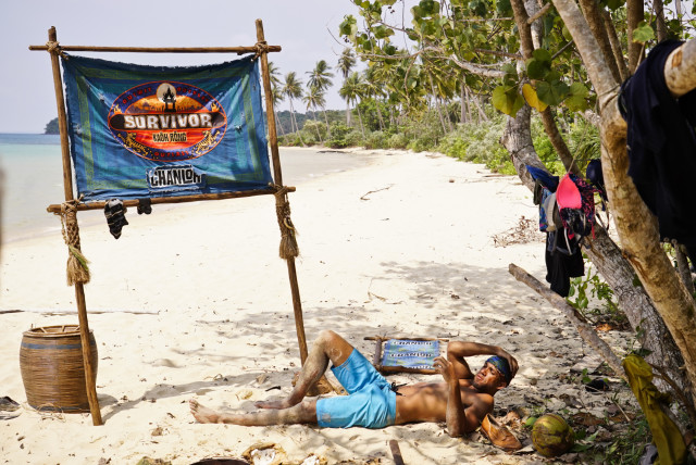 Peter Baggenstos lays at Brains beach on Survivor: Kaoh Rong