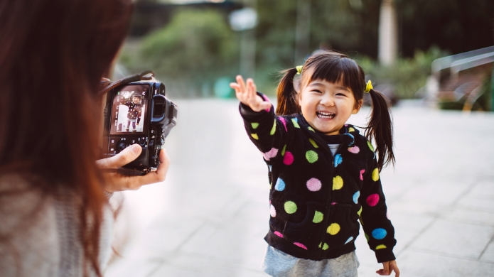 Mom taking picture for lovely toddler