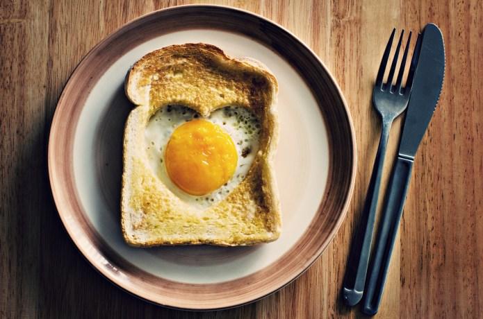 Heart egg on toast served on