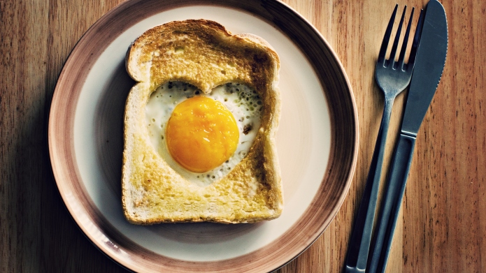 Heart egg on toast served on