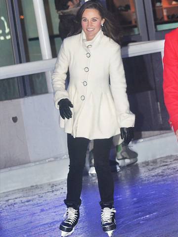 Pippa Middleton on ice skates wearing a Dom&Ruby coat