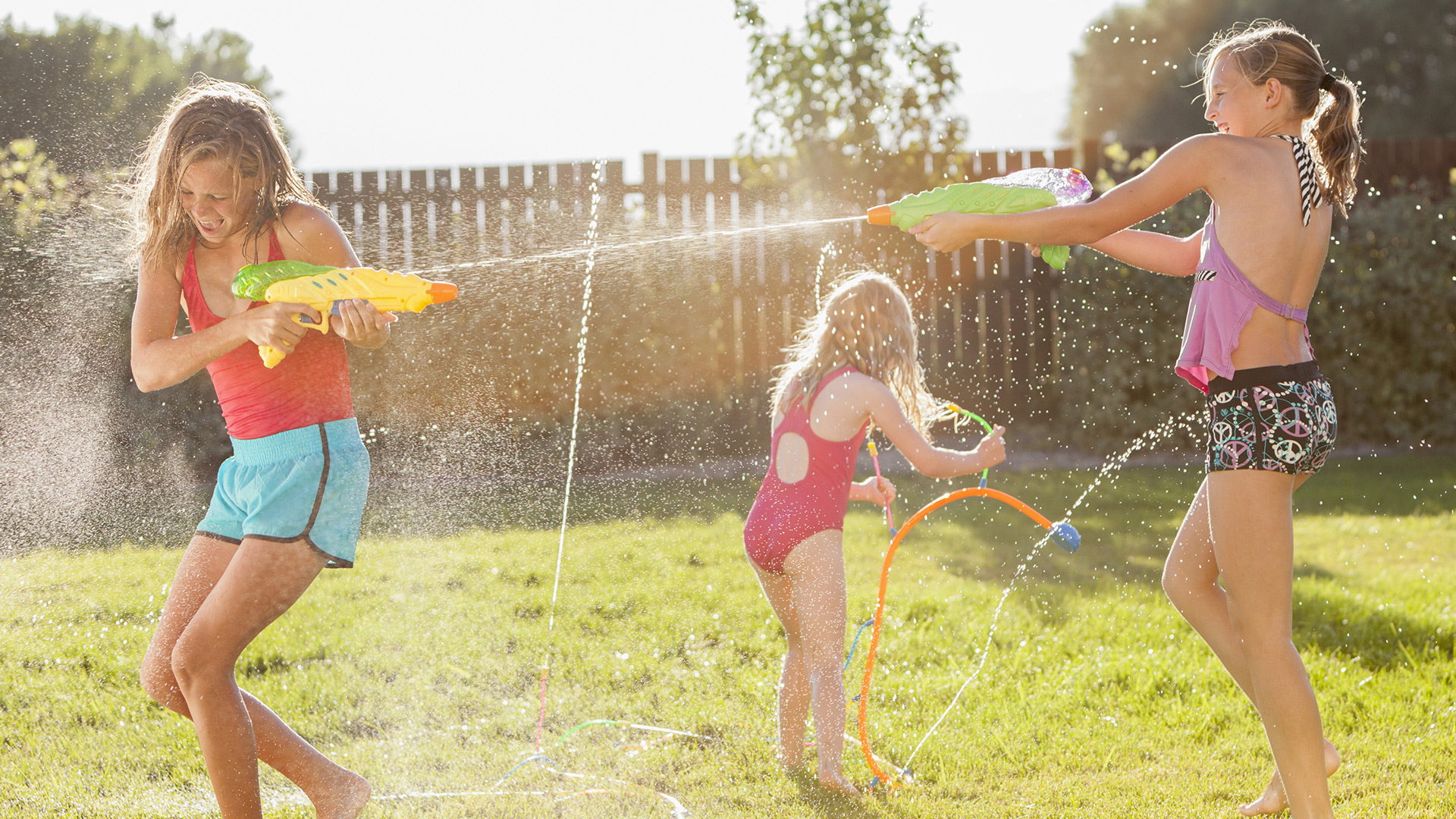 Playing with sprinklers | Sheknows.com